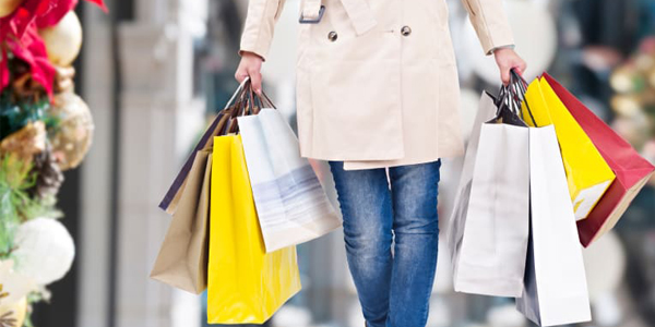 Holiday Budget Tips woman with shopping bags