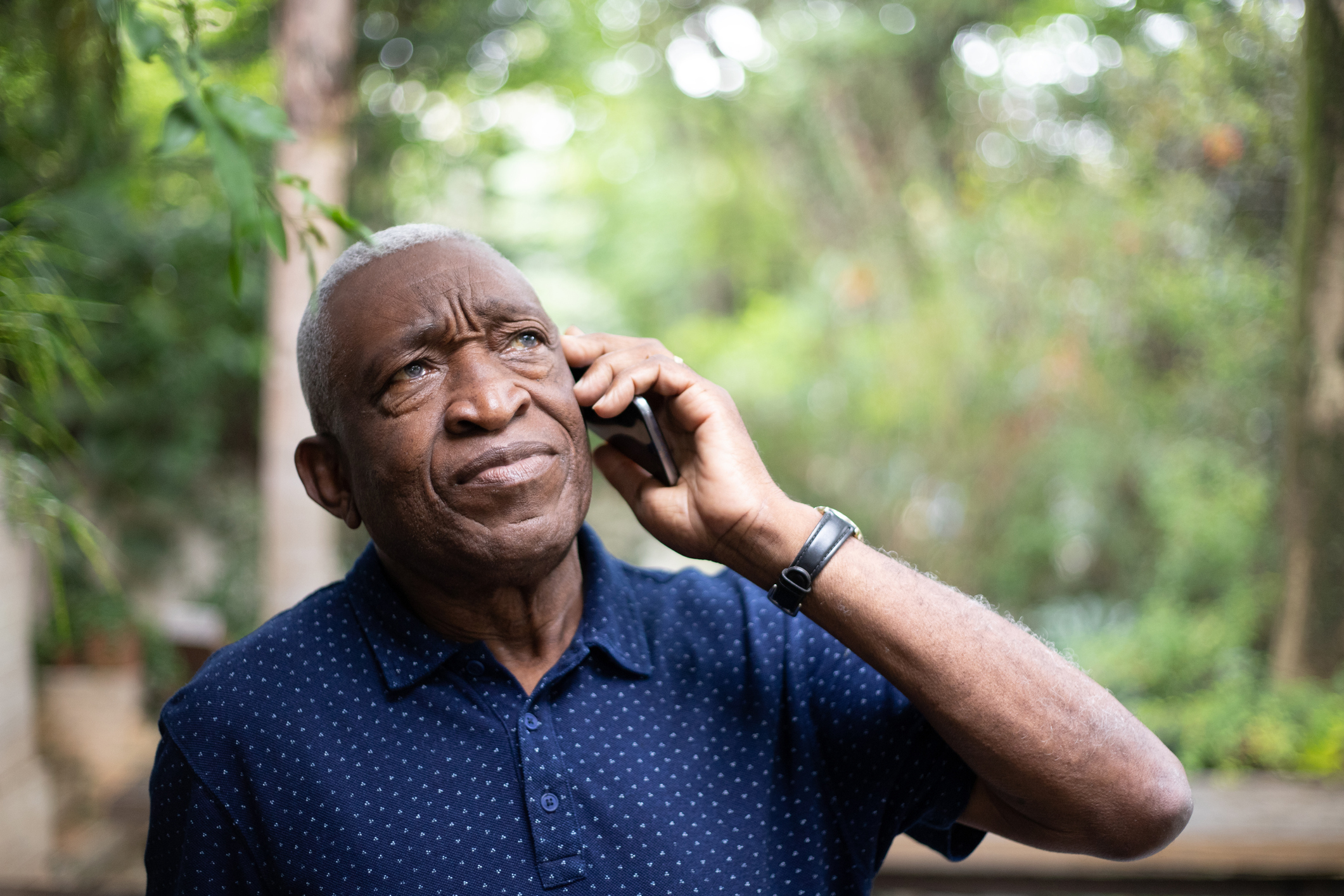 African american senior male listening to phone call