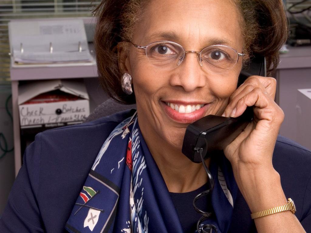 smiling bank employee on phone