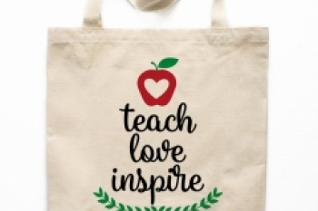 Tote bag with words teach love inspire printed on the front Banner
