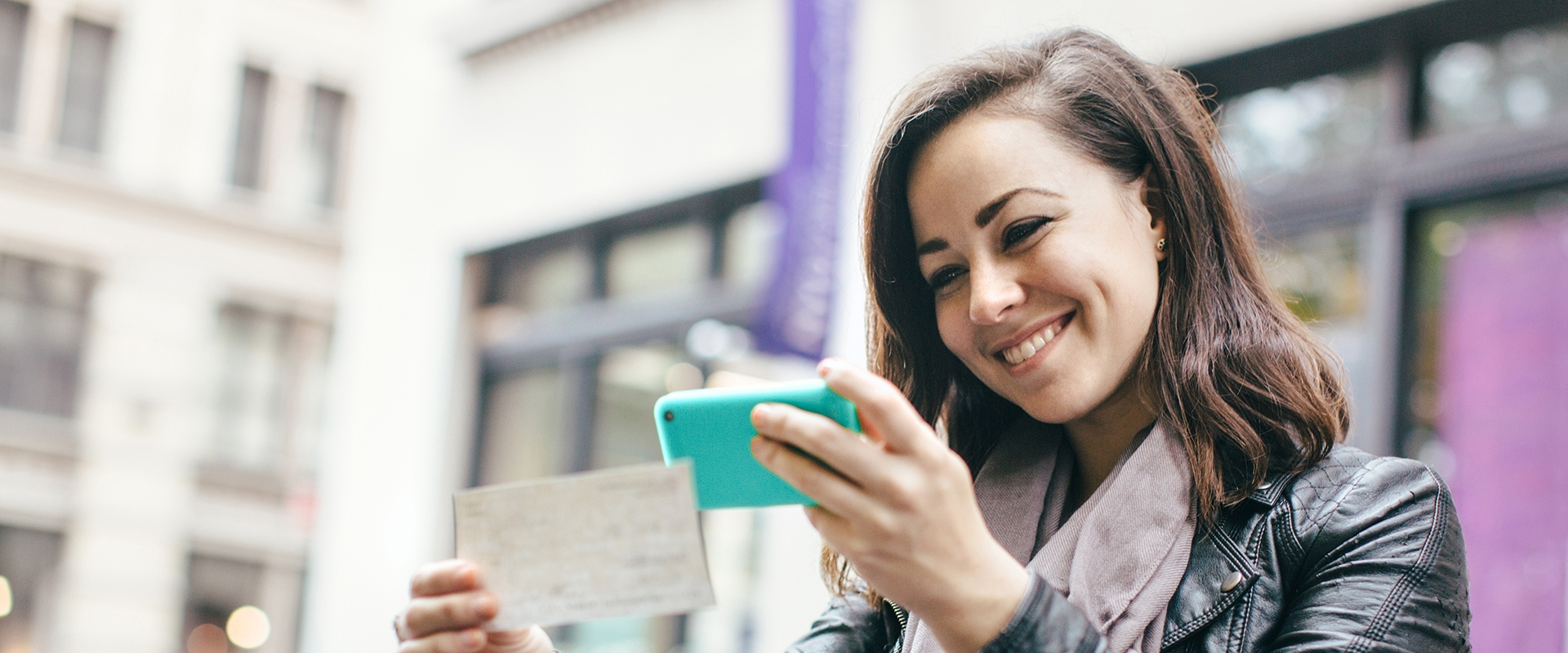 Female taking a picture of a check for mobile deposit Banner