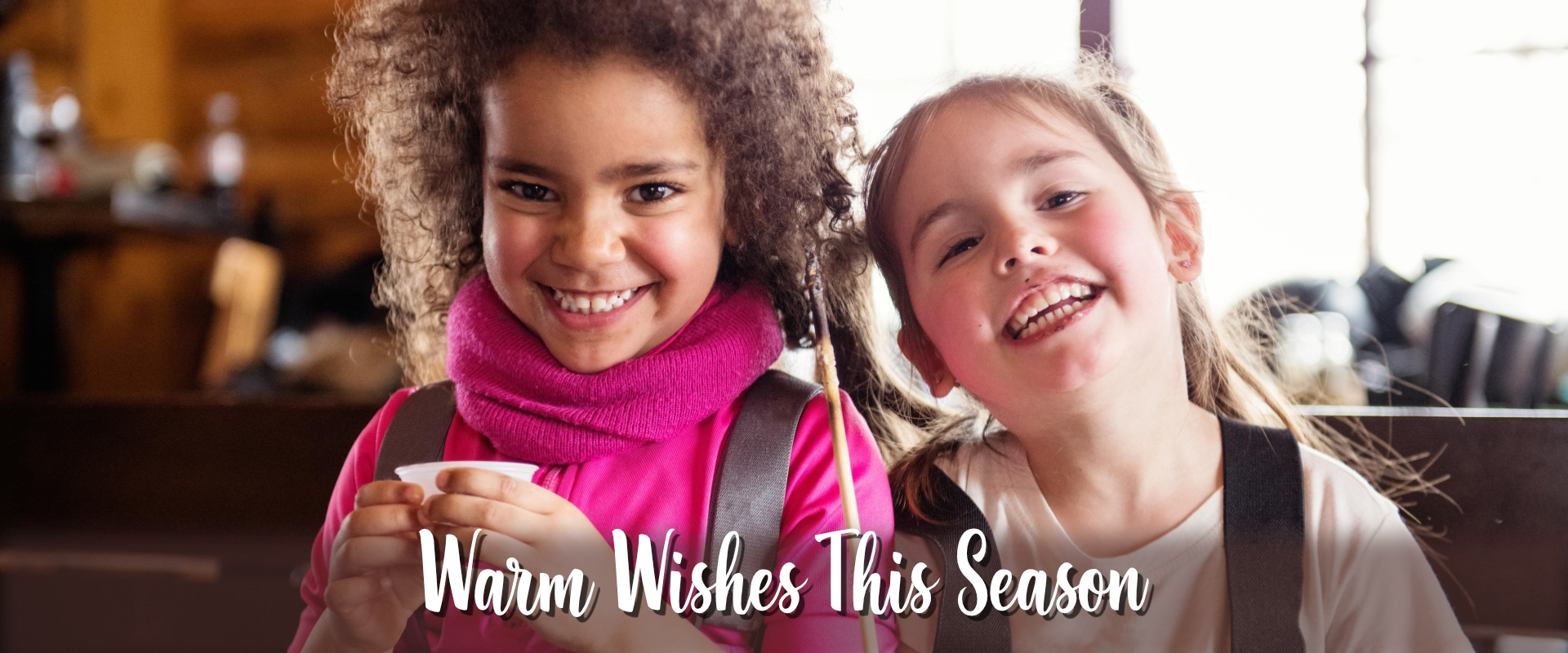Warm Wishes image with two little girls smiling Banner